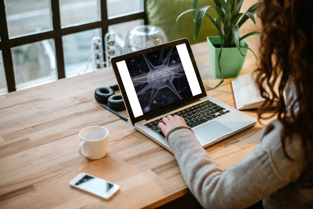 Woman looking at a completed NeuroSmart® Predictive Temperament Assessment report